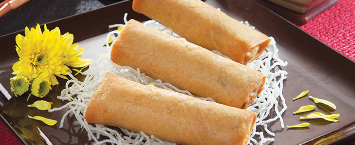 Plate of foodservice Amoy Asian Vegetable Spring Rolls in a restaurant setting