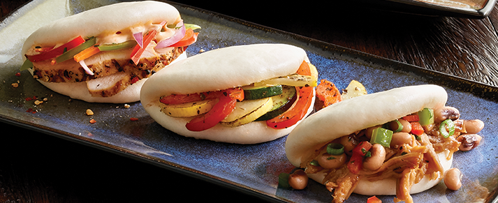 Plate of foodservice Amoy Asian Bao Buns in a restaurant setting