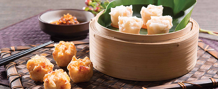 Basket of foodservice Amoy Asian Shrimp Shaomai in a restaurant setting