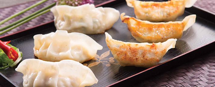 Plate of foodservice Amoy Asian One-bite Vegetable Potstickers in a restaurant setting