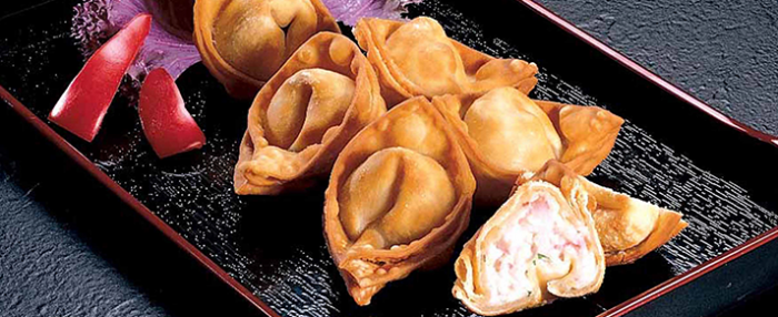 Plate of foodservice Amoy Asian Crab Rangoons in a restaurant setting