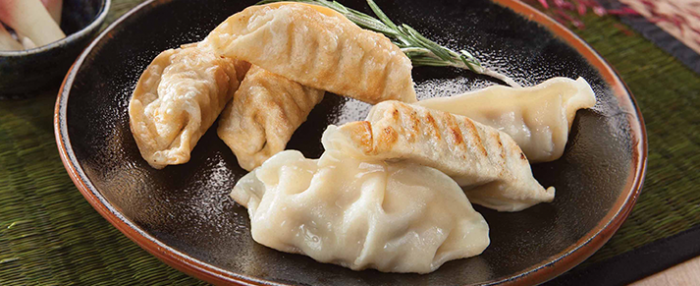 Plate of foodservice Amoy Asian Pork Potstickers in a restaurant setting