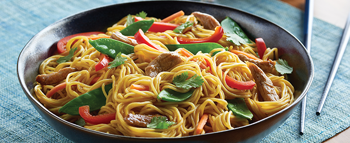 Bowl of foodservice Amoy Asian Chow Mein Noodles in a restaurant setting