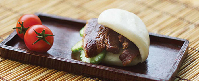 Pate of foodservice Amoy Asian Pork Belly Bao in a restaurant setting