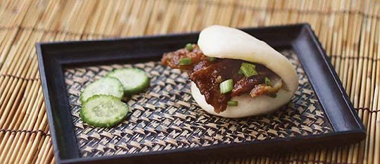 Plate of foodservice Amoy Asian Barbeque Pulled Pork Bao in a restaurant setting