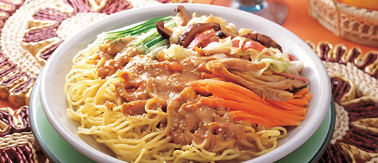 Plate of foodservice Amoy Asian Cold Noodle Salad in a restaurant setting