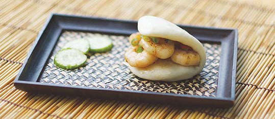 Plate of foodservice Amoy Asian Seared Shrimp Bao in a restaurant setting