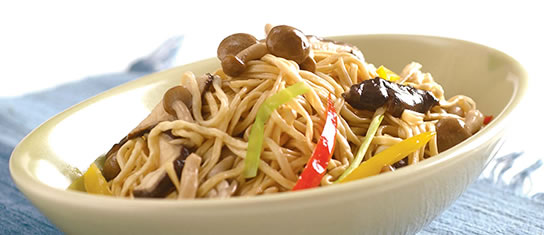 Bowl of foodservice Amoy Asian Spicy Curry Noodle Salad in a restaurant setting