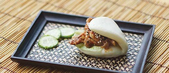 Plate of foodservice Amoy Asian Teriyaki Chicken Bao in a restaurant setting