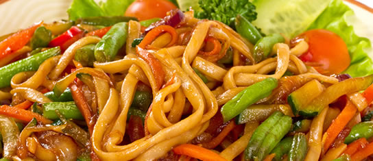 Plate of foodservice Amoy Asian Vegan Cold Noodle Salad in a restaurant setting